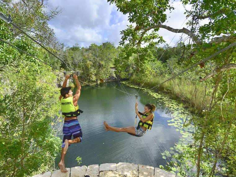Open water cenote zip lining at Xenotes Park in the Riviera Maya