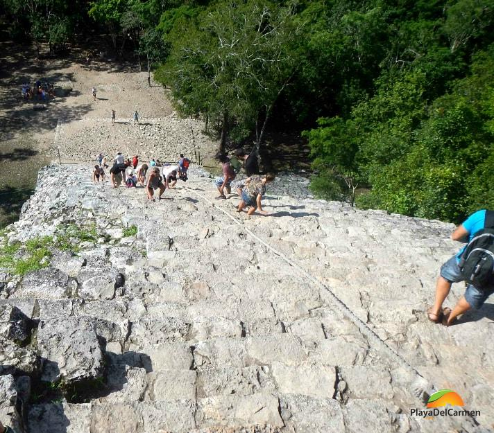 Picture of the Coba pyramid from the top with people climbing it