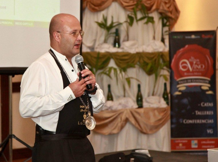 A sommelière speaks at the Riviera Maya Mexican Wine Festival