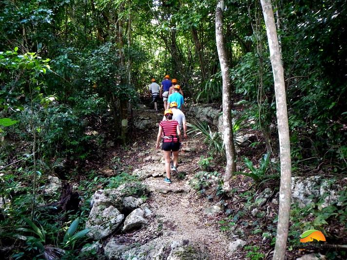 People hiking in the jungle near the Coba pyramid