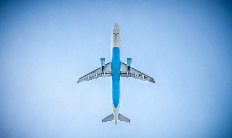 Airplane flys over Playa del Carmen