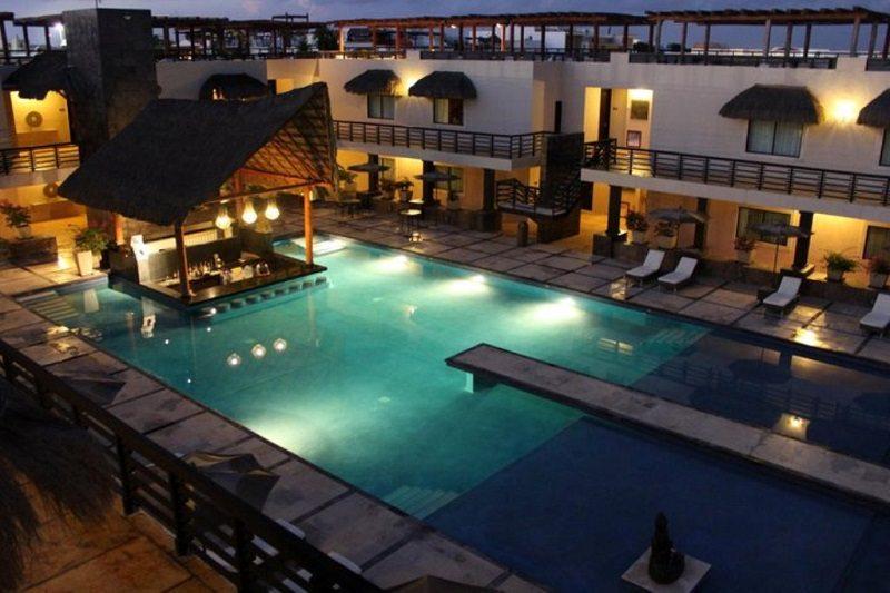 Aldea Thai Luxury Condo Hotel at night