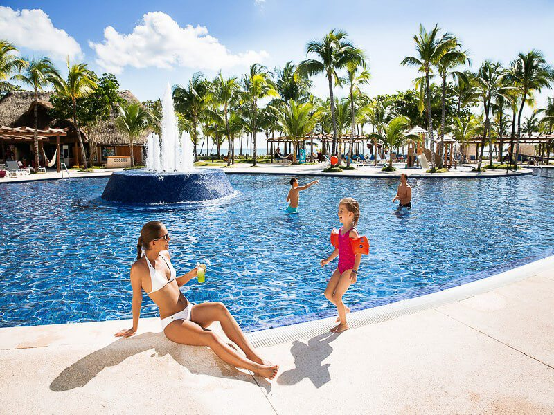 People having fun at Barcelo Maya Beach swimming pool