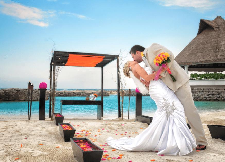 Wife and Husband kissing at Hard Rock Beach