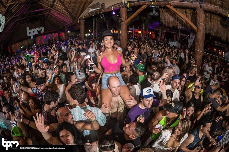 The crowd dances to the beats of the DJ at the BPM Festival in Playa del Carmen