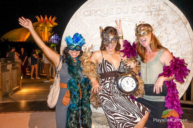 Travel specialists from PlayaDelCarmen.com pose in costume at Cirque Du Soleil Riviera Maya