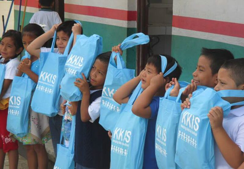 Kids with blue bags at the Keeping Kids in School Project in Playa del Carmen
