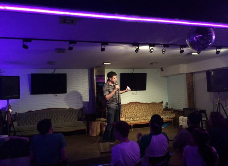 Comedian Jon Selig performs for Comedy Abroad