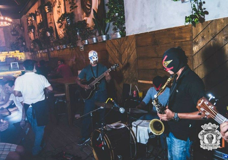 Mask wrestlers play a live set at La Drinkeria by Henry Miller in Playa del Carmen