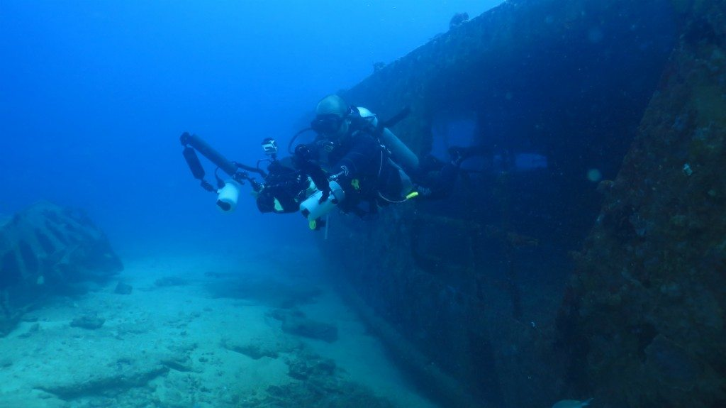 Blue Core diver investigating eagle rays at a shipwreck off the coast of Puerto Morelos
