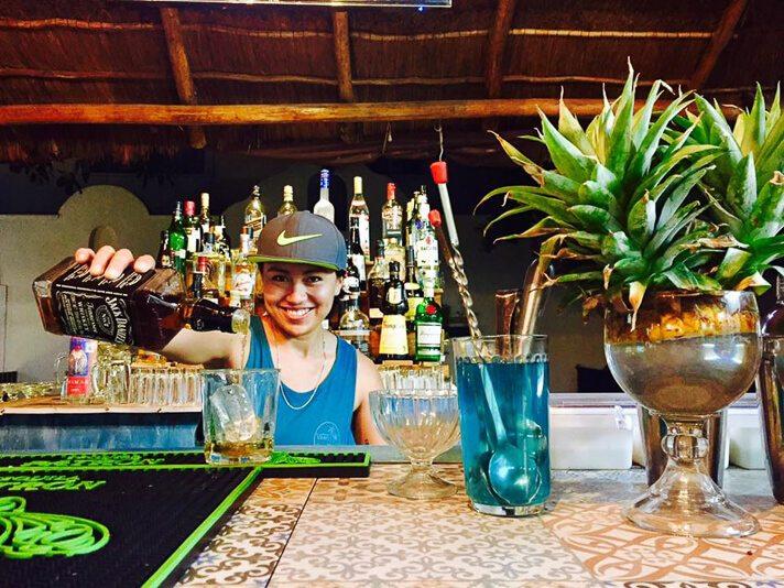 Bartender at bar at El Curandero seafood in Playa del Carmen