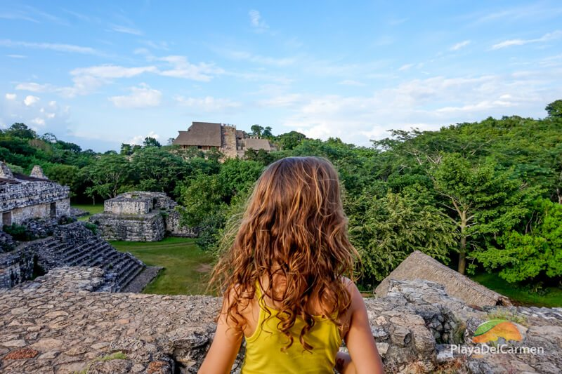 Girl looking at Mayan pramid in Ek Balam