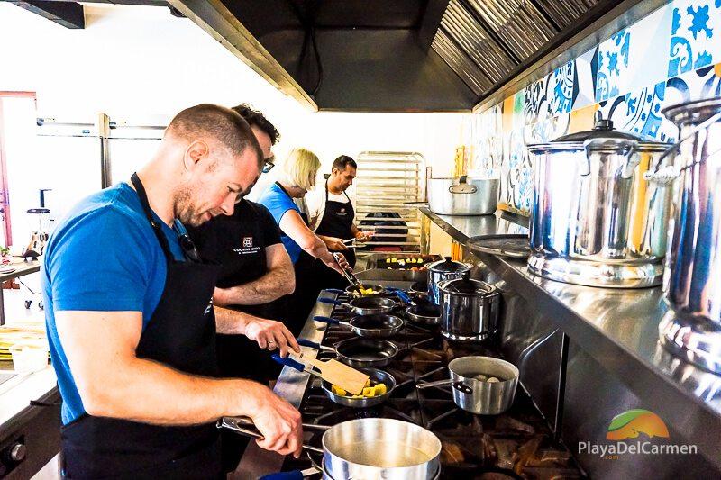 Students prepare meal at El Pueblito Cooking School