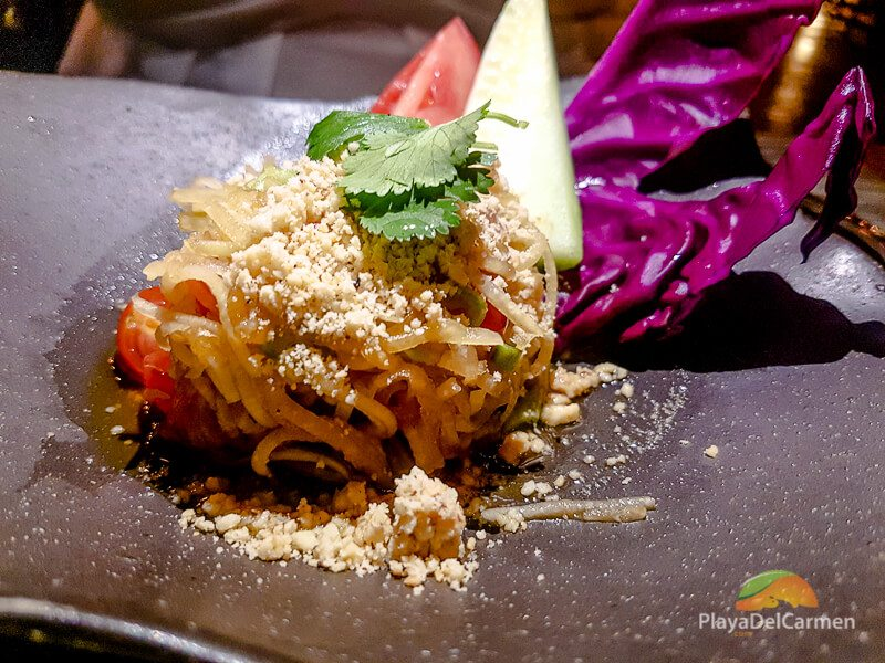 a spicy green papaya salad served with dry shrimp at koh thai restaurant
