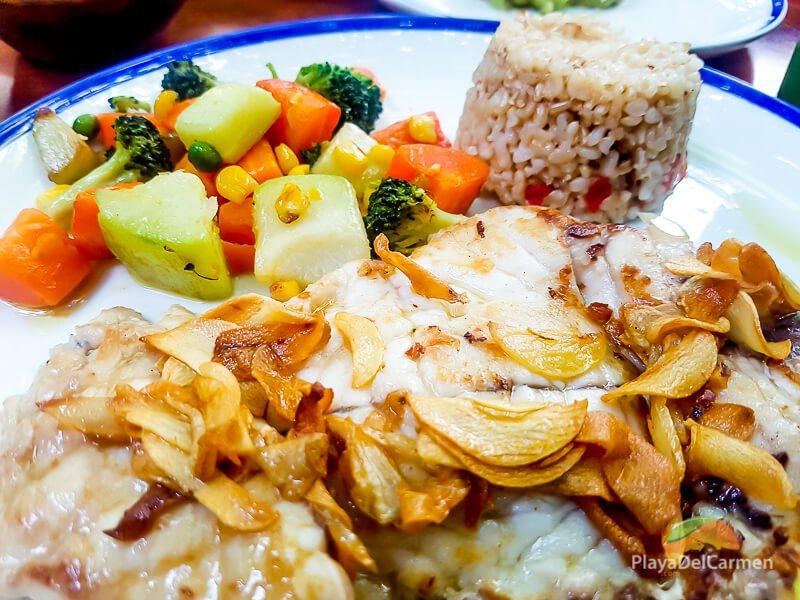 a portion of brown rice accompanied my delicious fillet at La Cueva del Chango