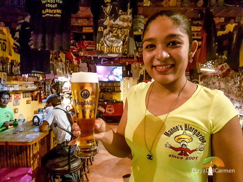Girl holding beer at Manne's Biergarten