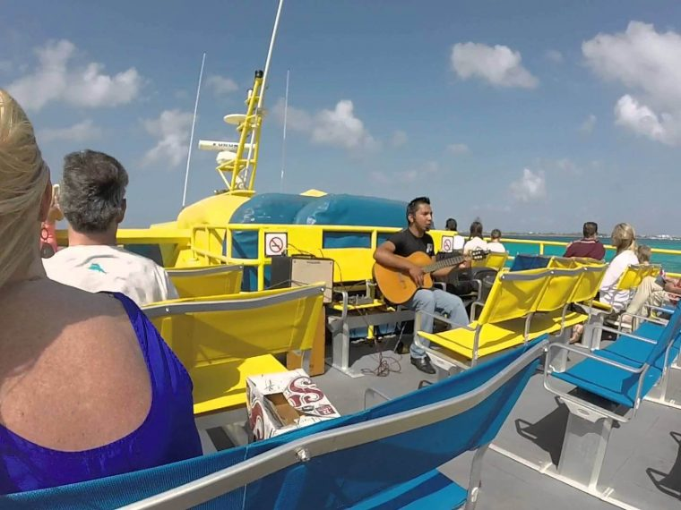 Guy playing guitar on ultramar boat