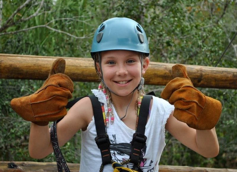 Girl gives two thumbs up on Playa del Carmen zip line tour