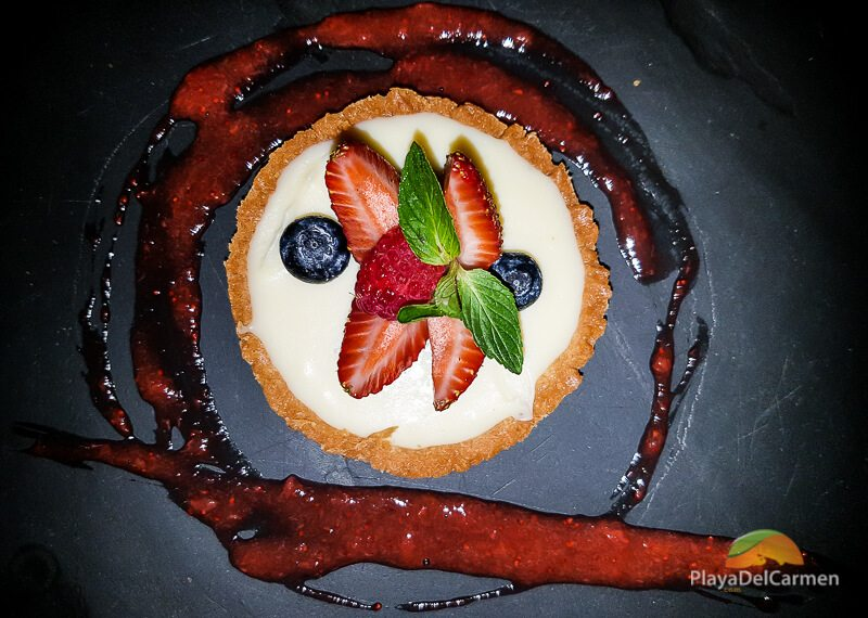White chocolate tartlet with raspberries and strawberries at Patanegra restaurant in Playa del carmen