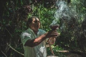 Person at mayan ceremony of balche in Punta Laguna, Tulum, México