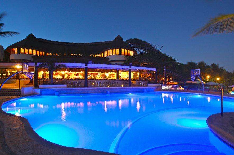 Reef Playacar Playa del Carmen pool at night