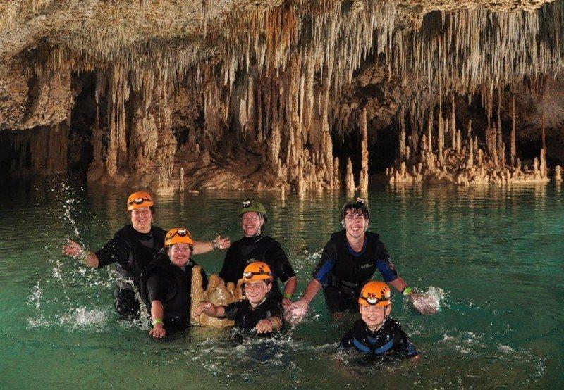 People enjoying the cenotes in the Rio secreto cenote
