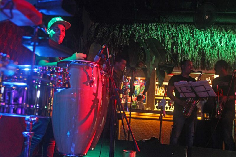 People performing latin music at Salón Salsanera, located in Cancun