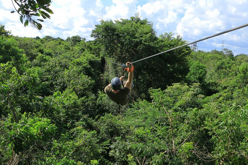 Guy zip lining at selvatica, cancun
