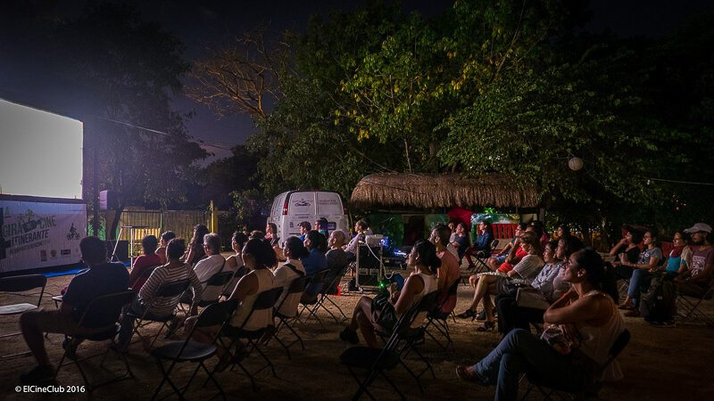 People watching a movie at cine club in playa del carmen