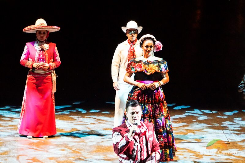 People performing in colorful dresses at Spectacular Mexico at Xcaret