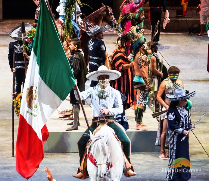 Person on horse with the mexican flag on stage at Spectacular Mexico at Xcaret